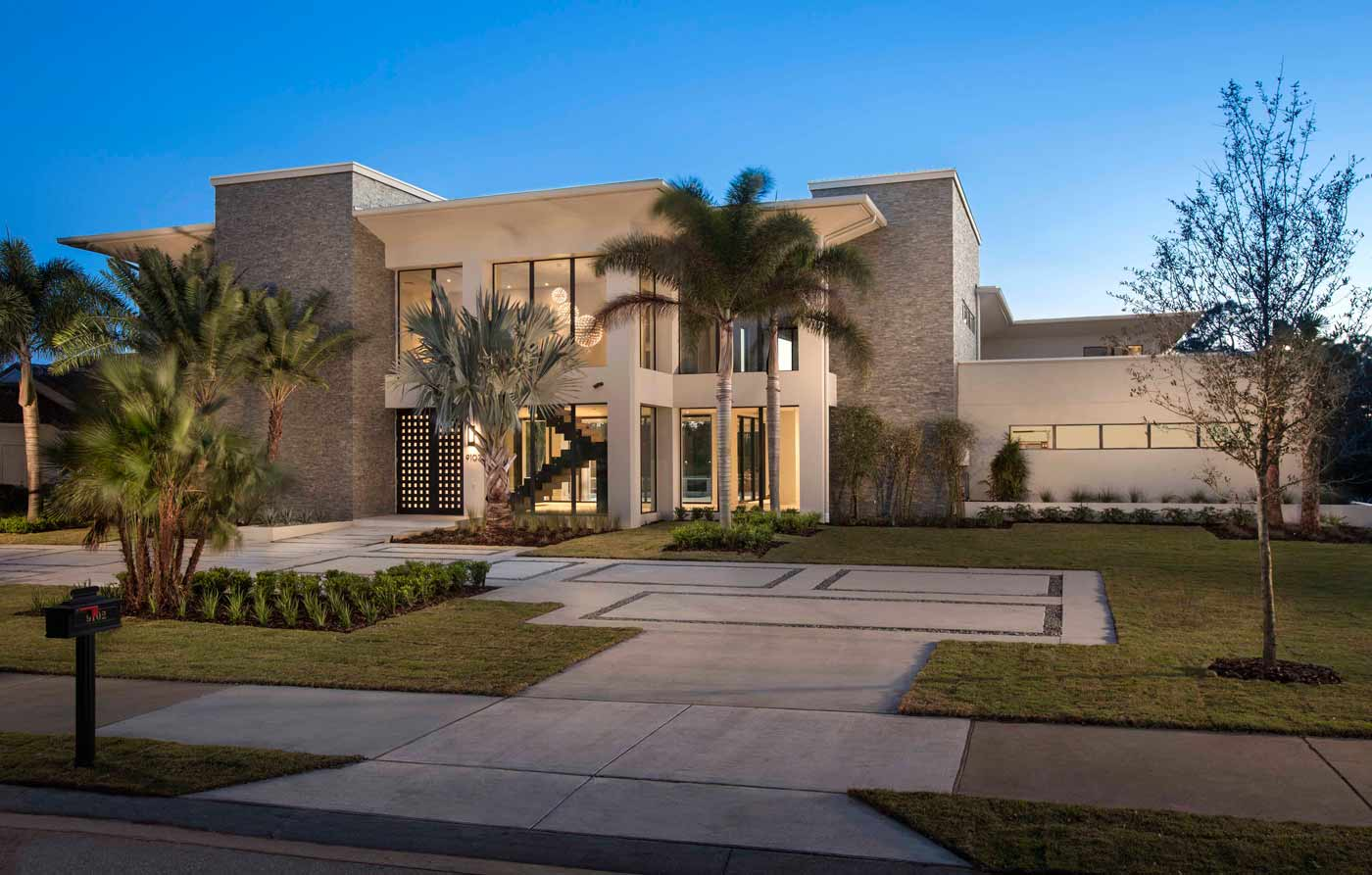 Red8's façade blends warm textures and mature landscaping to accent the home's modern design.