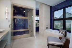 Iridescent tiles give this luxury modern bathroom a bold yet sophisticated pop of color.